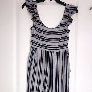 Brand new Women's XS grey and navy jumpsuit